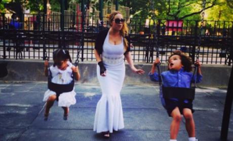 Mariah Carey Wears Ball Gown on Swings