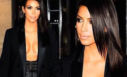 Kim Kardashian Flaunts INSANE Cleavage, Pretends She Is Not Doing So