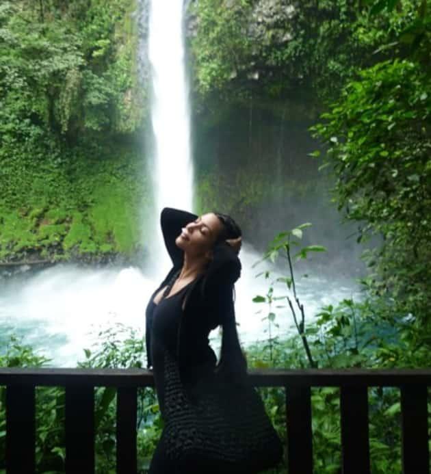 Kim Kardashian Near a Waterfall