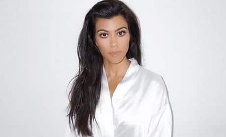 Kourtney Kardashian in a Robe