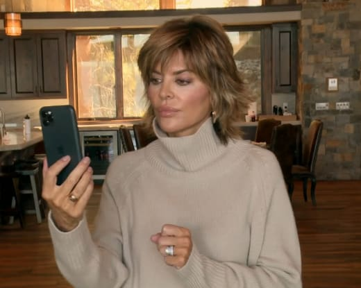 Lisa Rinna Stares at Her Phone Dubiously