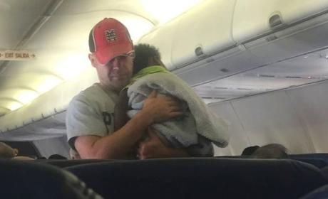 Stranger Soothes Baby on Plane, Earns Hero Status