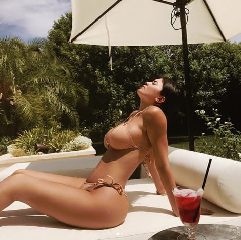 Kylie Lounges in a Nude Bikini