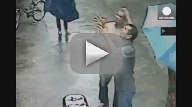 Men Catch Falling Baby in China