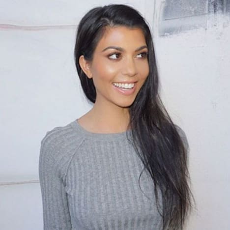 Kourtney Kardashian smiling