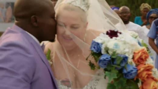 Michael Ilesanmi kisses Angel Deem through the shield