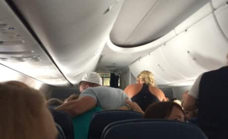 Tim Tebow Comforts a Family Mid-Air