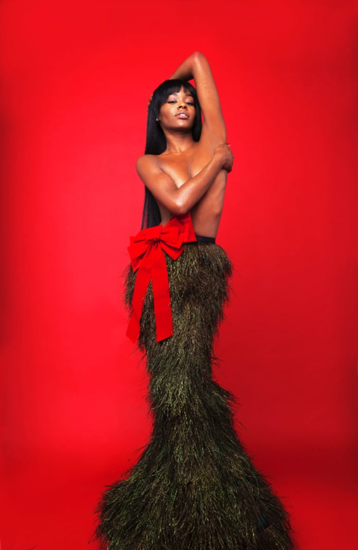 Azealia Banks Posts Topless Christmas Selfie, Gives Beef a Rest For ...