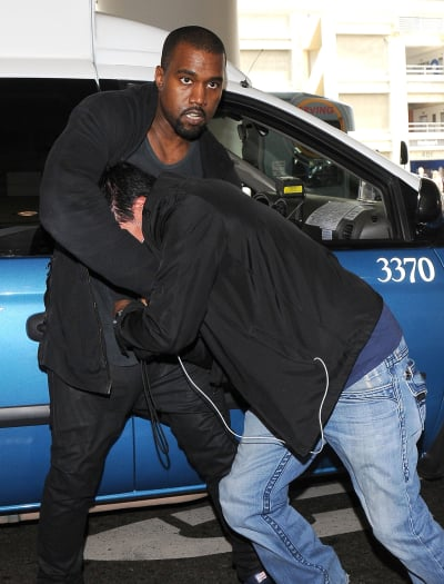 Kanye West vs. Photographer