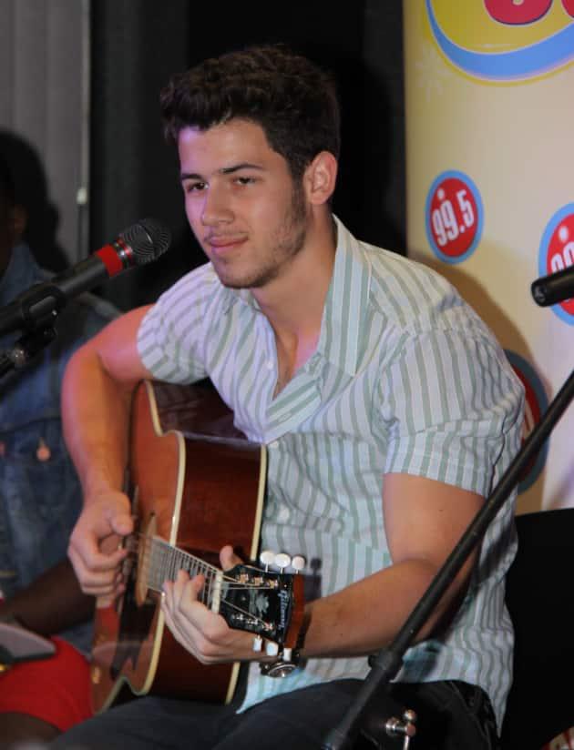 Nick Jonas on the Guitar