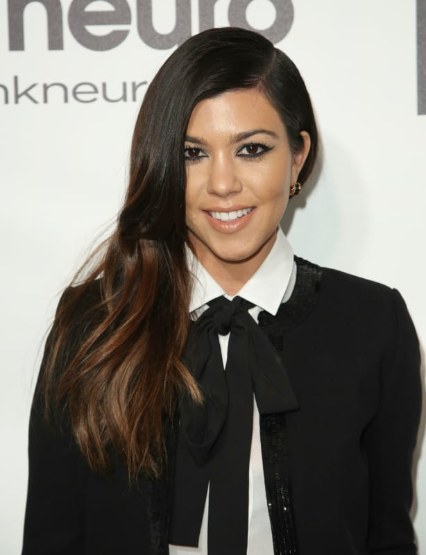 Kourtney Kardashian in a Suit