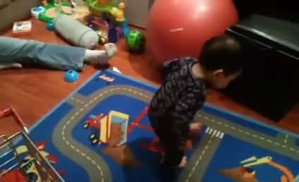 Little Boy Discovers, Plays With Shadow