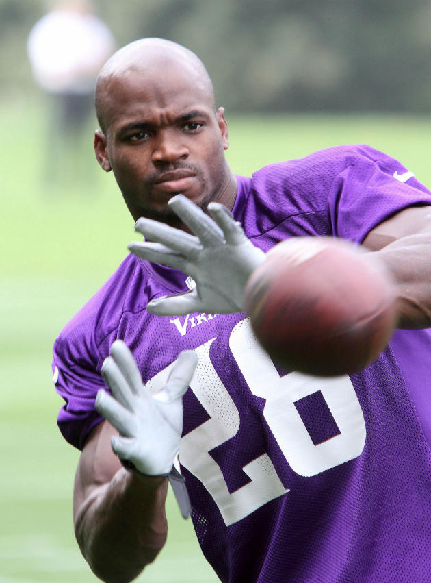 Adrian Peterson with a Football