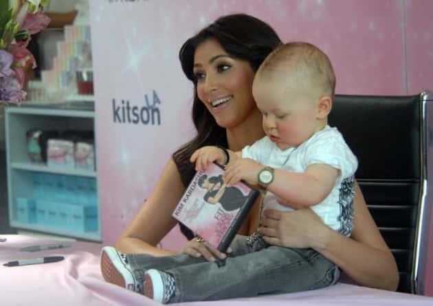 Kim Kardashian Kovers Dvd Katers To Fans Klutches Baby