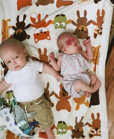 Jackson Roloff and Ember Jean on a Baby Blanket