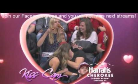 Hottest Kiss Cam Kiss EVER Doesn't Phase Passionate Pizza Eater