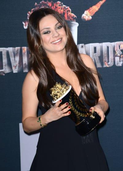 Mila Kunis with MTV Movie Award
