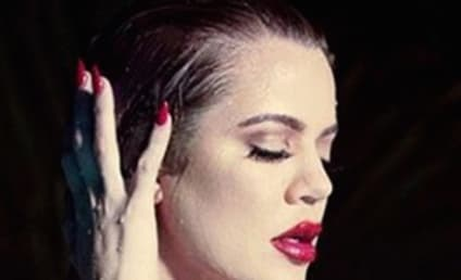 Khloe Kardashian Goes Topless, Likens Herself to Marilyn Monroe