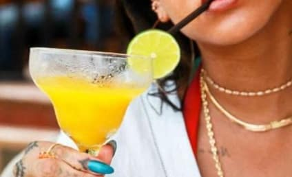 Rihanna Rocks Bikinis, Pounds Booze in Racy Vacation Pics