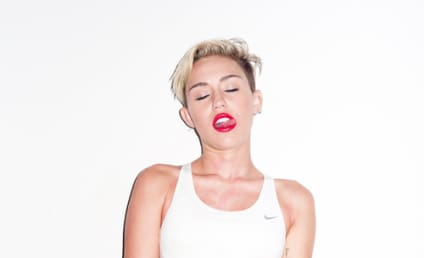 Miley Cyrus: Standing on Her Hands, Flipping Us Off