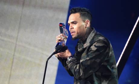 Chris Brown Accepts Award in Front of Crowd