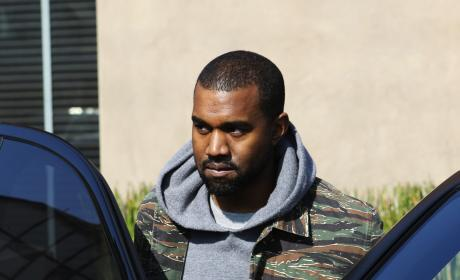 Kanye West Into His Car