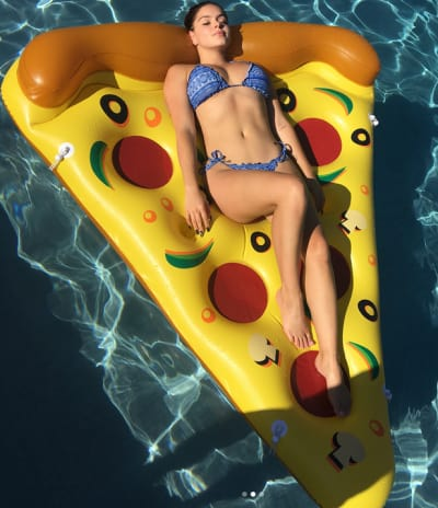 Ariel Winter Lays on a Pizza