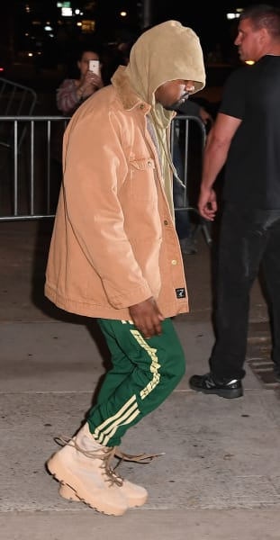 Kanye West in a Tan Jacket and Green Pants Photo