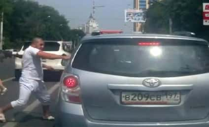 Kung Fu Road Rage: Dude Goes Bruce Lee on Car, Gets Rear-Ended in Response