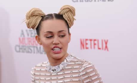 Miley Cyrus in braid buns