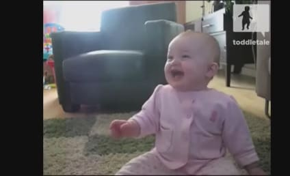 Baby Laughs at Dog Eating Popcorn, Internet Collectively Melts