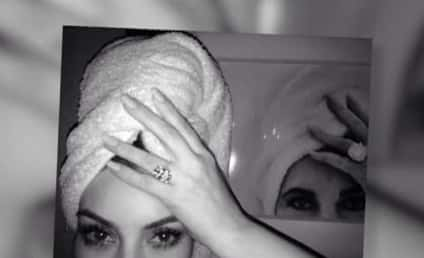 "Kim Kardashian Kompares Self to Elizabeth Taylor, Strikes Same Pose as Her ""Idol"""