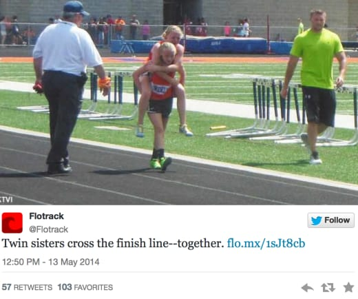 Twins Carries Sister