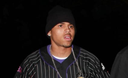 Chris Brown Takes Hat Off to Tiger Woods