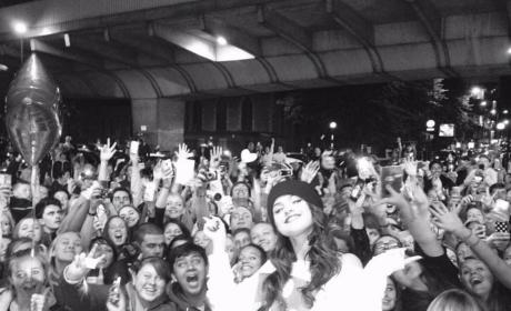 Selena Gomez poses with fans