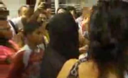 Cyndi Lauper Serenades Crowd at Airport
