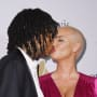 Amber Rose and Wiz Khalifa Kiss