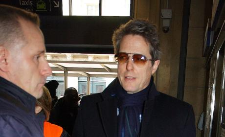 Hugh Grant and his girlfriend Anna Eberstein arrive at Gare du Nord station in Paris