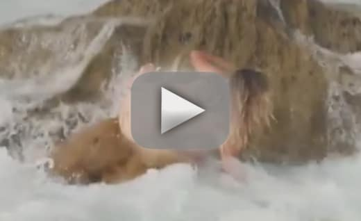 Kate upton swept off rock during topless photoshoot