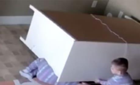 2-Year Old Plays Hero, Lifts Fallen Dresser Off Twin