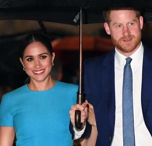 Meghan Markle and Prince Harry Under an Umbrella