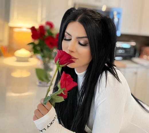 Larissa Lima Smells a Red Rose