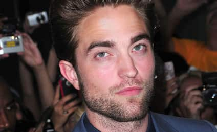 Robert Pattinson Walks Red Carpet of Cosmopolis Premiere