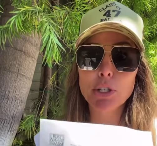 Kelly Dodd holds up legal notice from Dubrow family attorney