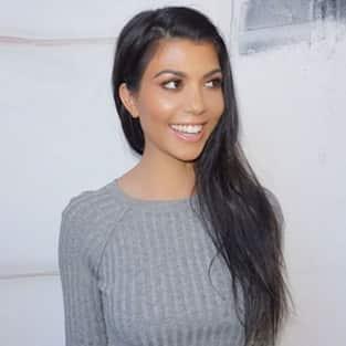 Kourtney Kardashian smiling
