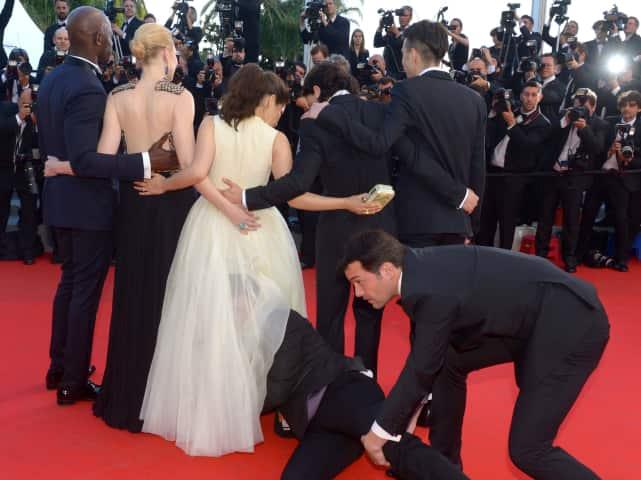 Guy Crawls Under America Ferrera's Dress
