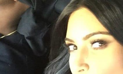 Kim Kardashian Blindfolds Kanye West, Poses with Laker Girls