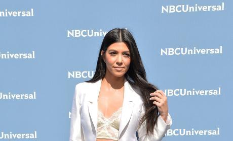 Kourtney Kardashian in a White Pantsuit Photo