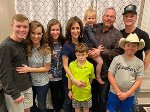Justin Duggar With the Spivey Family