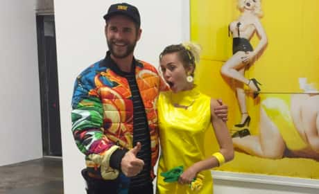 Miley Cyrus and Liam Hemsworth in an Art Gallery